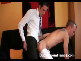 Detached defy in suit assfucks naked dude