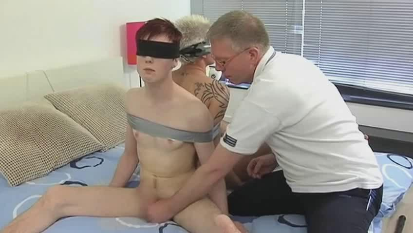 Mature gay pater ties two sex-mad twinks and suck their dicks
