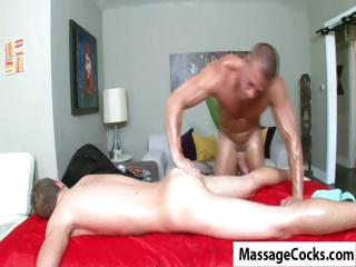 Twink comes adjacent to be advantageous to a kneading and gets his cock jerked by his cheerful masseur