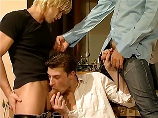 Three hot gay dudes having threesome sex impersonate in living room