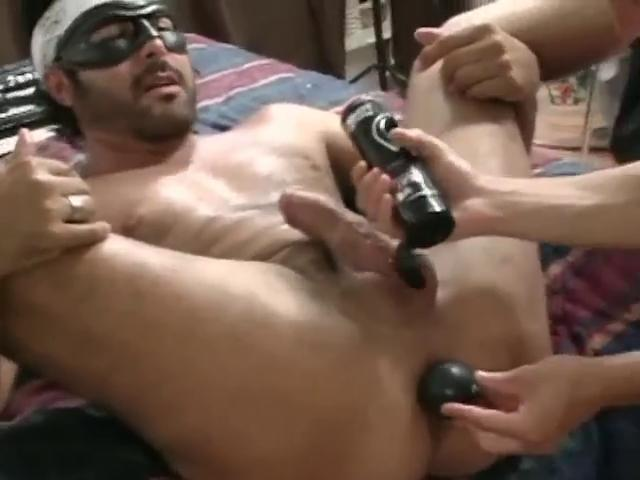 Masked hunky gay gets his tight pain in the neck stretched round a large dildo