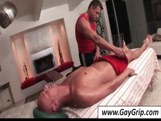 Ripped unconcerned stallion giving his baldheaded fellow-worker a tender rub down