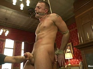 Porn superstar Jessie Colter gets bound, gagged with an increment of edged until he begs to cum.