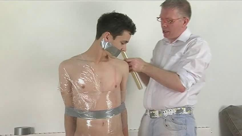 Skinny dark haired gay gets tied coupled with wrapped like a mummy