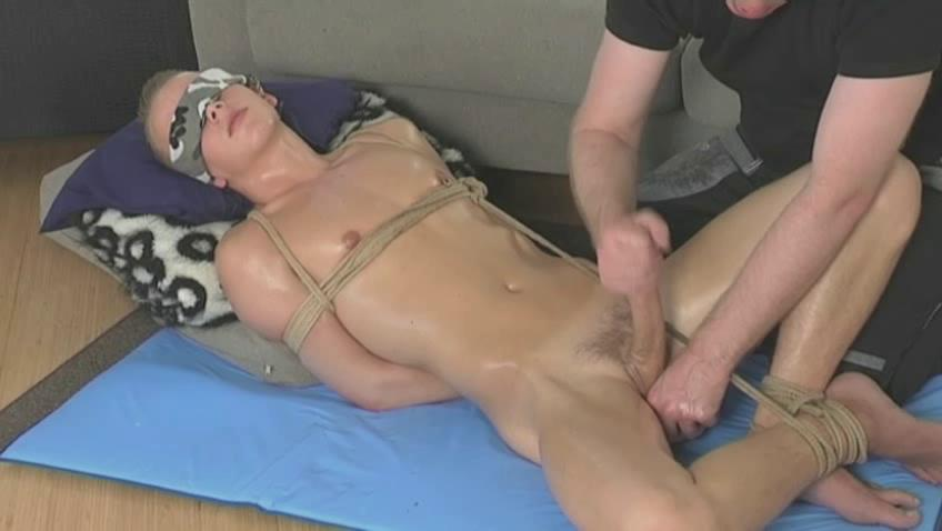 Tied up twink getting his learn of stroked