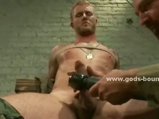 Submissive gay cadger gets agonizing coupled with teased by a cadger that forces him to drag inflate his cock