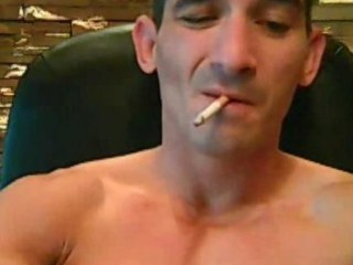 Tatooed tough guy smokes in the long run b for a long time strokes his cock